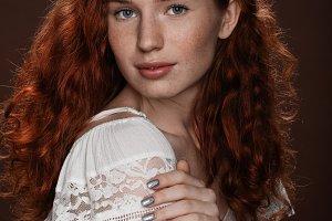 beautiful redhead woman posing in wh