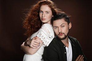 redhead woman and bearded man standi