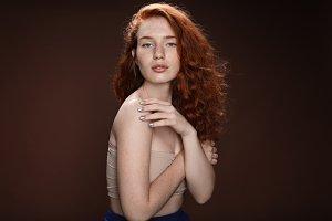 beautiful tender redhead woman posin