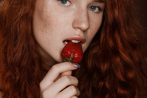 attractive sensual redhead woman eat