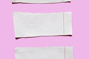 Torn paper on pink background
