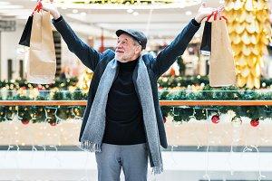 A happy senior man doing Christmas