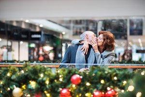 A senior couple in shopping center