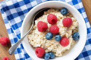 Oatmeal porridge bowl with berries