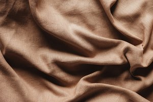 top view of beige linen tablecloth t
