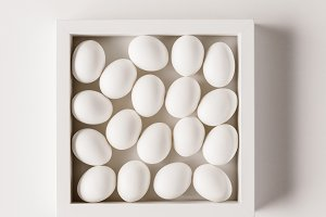 top view of chicken eggs in frame on