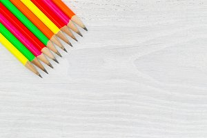 Bright colorful pencil tips on wood