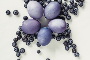 top view of purple easter eggs and b