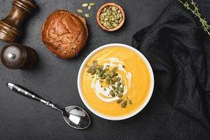 Tasty pumpkin cream soup in bowl