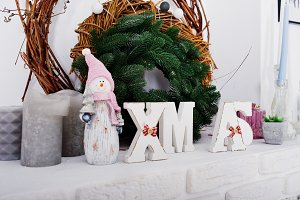 X-Mas word decor with wreath. Happy