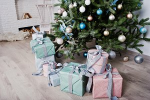 Gifts boxes under new year tree at w