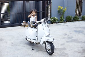 little children sit Play on scooter