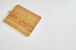 Wooden cutting board on white table
