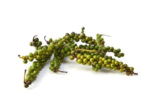Bunches of fresh green peppercorns