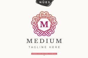 Geometric Emblem M Logo