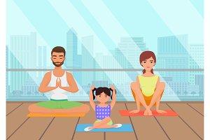 Family meditating in fitness room.