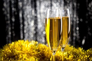 Two champagne or wine glasses with g