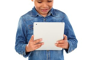 Latin funny child with a tablet
