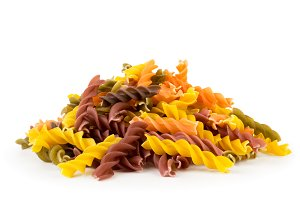 Bunch of colored pasta on a white