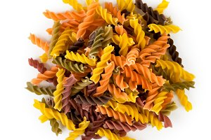 A bunch of colored pasta spiraling