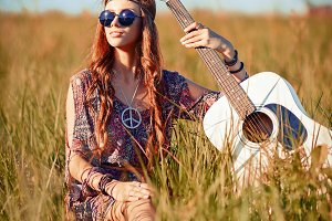 Lovely young hippie girl with guitar