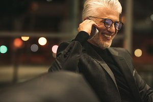 Mature businessman talking on cell
