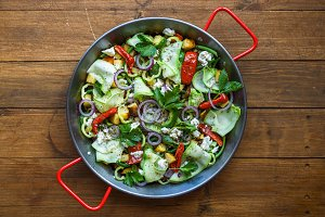 Stir fried vegetables in a pan, top