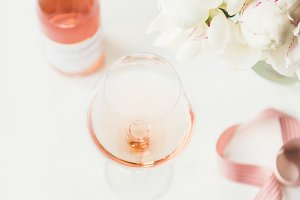 Rose wine in glass, pink ribbon