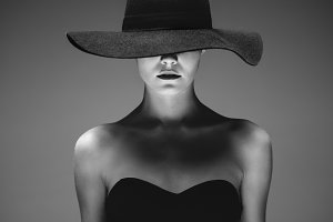 Beautiful elegant woman in a hat