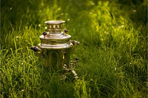 Rustic samovar on the fresh summer