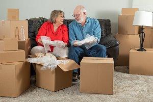 Senior Couple Unpacking  Moving Day