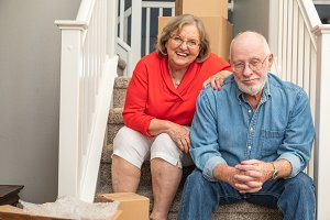 Senior Couple On Stairs Moving Day