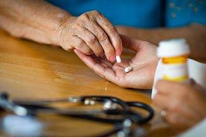 Senior Woman Taking Medicine Pills