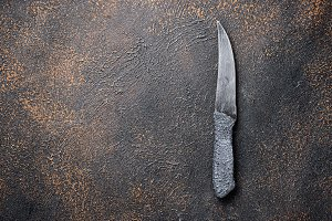 Knife on rusty table. Culinary