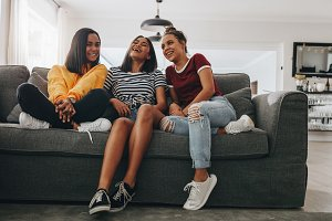 Girls sitting on couch at home