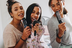 Three girls enjoying singing