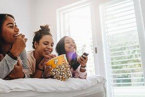 Girls watching television lying