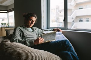 Student studying at home sitting