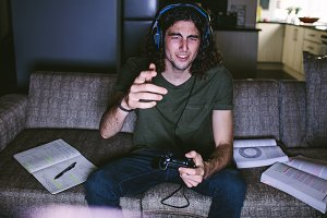 Student playing video game sitting