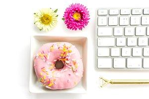 Pink doughnut and keyboard