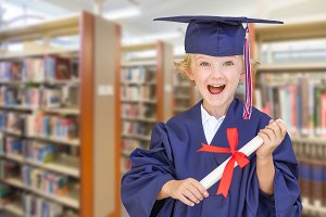 Cute Caucasian Boy in Cap and Gown