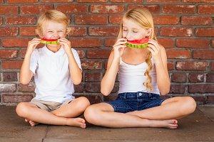 Cute Boy and Girl Eat Watermelon