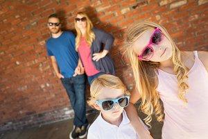 Caucasian Family Wearing Sunglasses