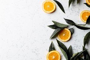Flat lay orange slices, orange tree