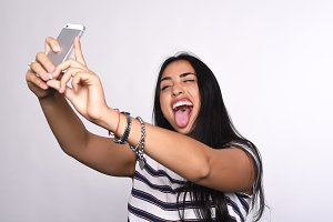 Young woman taking selfie with smart