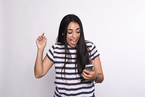 Woman excited with smartphone