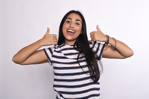 Young latin woman celebrating succes