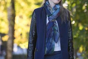 Girl in a coat and scarf against the
