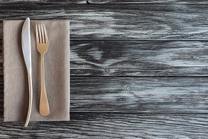 top view of fork and knife on napkin