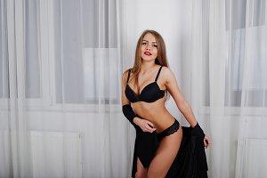 Gorgeous sexy woman at black shirt a